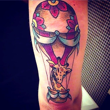 Giraffe In Hot Air Baloon Tattoo