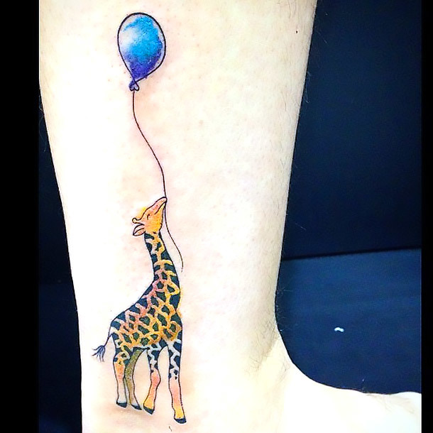 Giraffe With Baloon Tattoo Idea