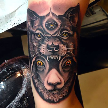 Wolf and Sheep Faces Tattoo