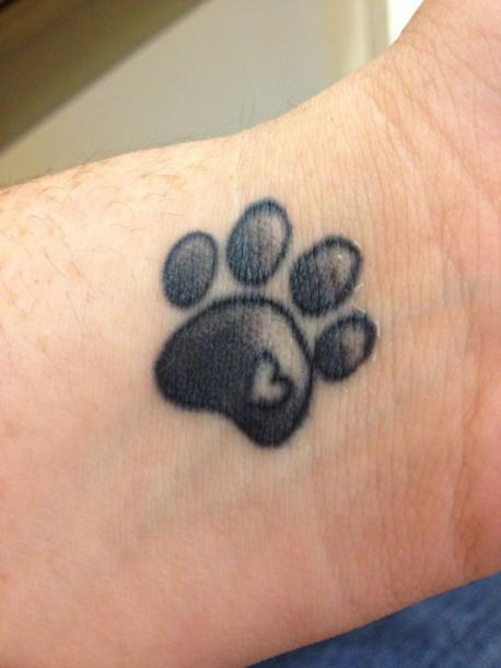 Lovely Cat Paw Print Tattoo Idea