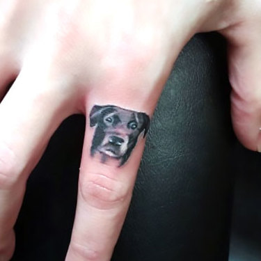Small Dog on Finger Tattoo