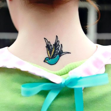 Small Swallow on Neck Tattoo