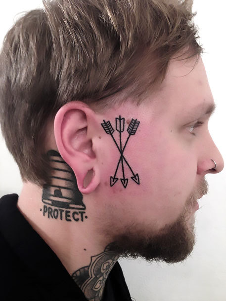 Small Arrows on Face Tattoo Idea