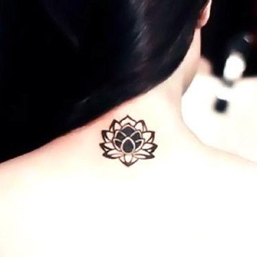 Small Neck Lotus Tattoo