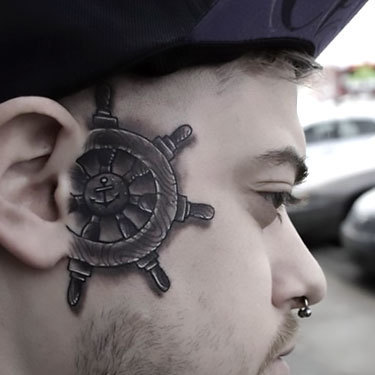 Small Helm Face Tattoo