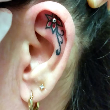 Small Flower on Ear Tattoo