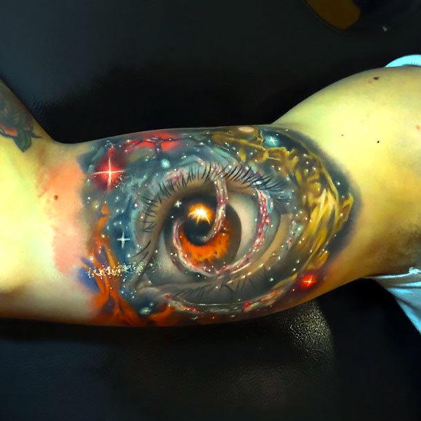 Space Eye on Bicep Tattoo Idea