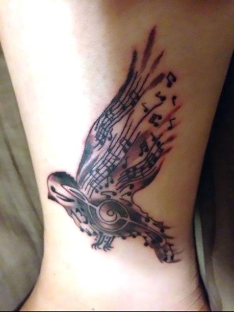 Songbird on Leg Tattoo Idea