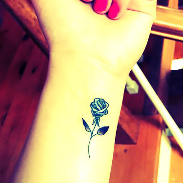 Small Rose on Wrist Tattoo