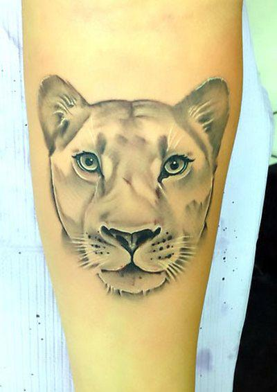 Amazing Lioness Face Tattoo Idea