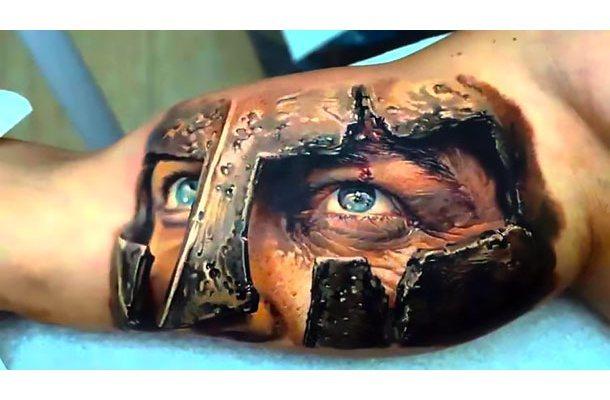 Spartan Head on Inner Bicep Tattoo Idea