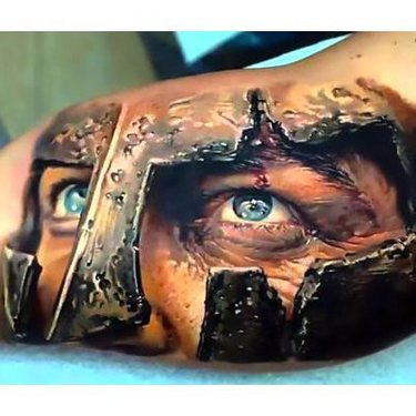 Spartan Head on Inner Bicep Tattoo