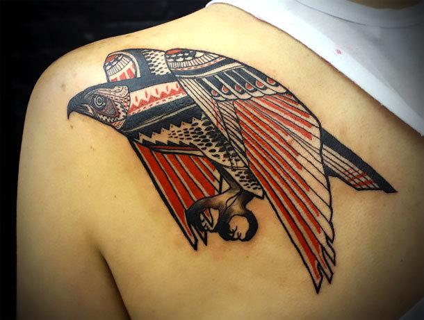 Shoulder Blade Men Tattoo Idea