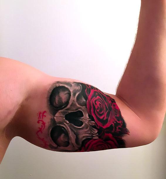 Skull and Rose on Inner Bicep Tattoo Idea