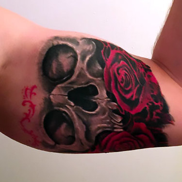 Skull and Rose on Inner Bicep Tattoo