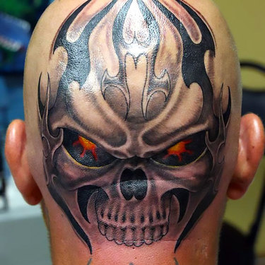 Skull on Head Tattoo