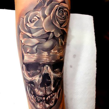 Skull and Rose on Forearm Tattoo