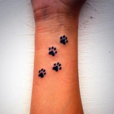 Cat Paw Prints on Wrist Tattoo