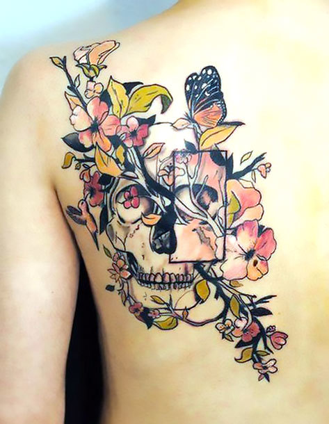 Floral Skull on Shoulder Blade Tattoo Idea