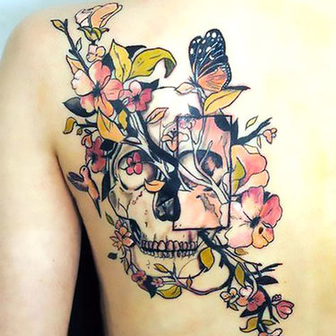 Floral Skull on Shoulder Blade Tattoo