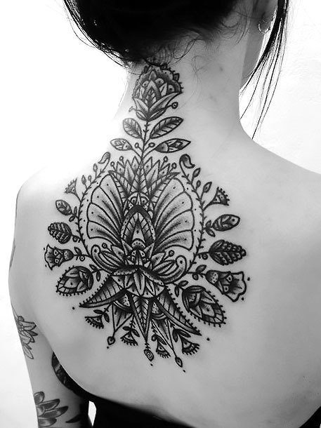 Flowers on Back for Ladies Tattoo Idea