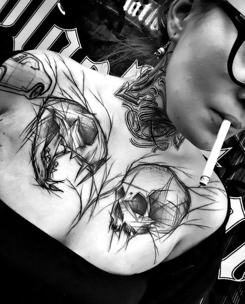 Amazing Skull Tattoo on Collar Bone Tattoo Idea
