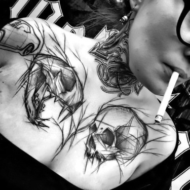 Amazing Skull Tattoo on Collar Bone Tattoo