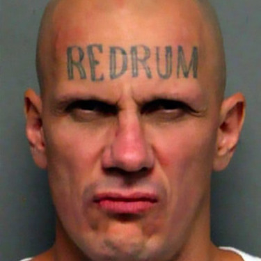 Creepy Redrum Tattoo