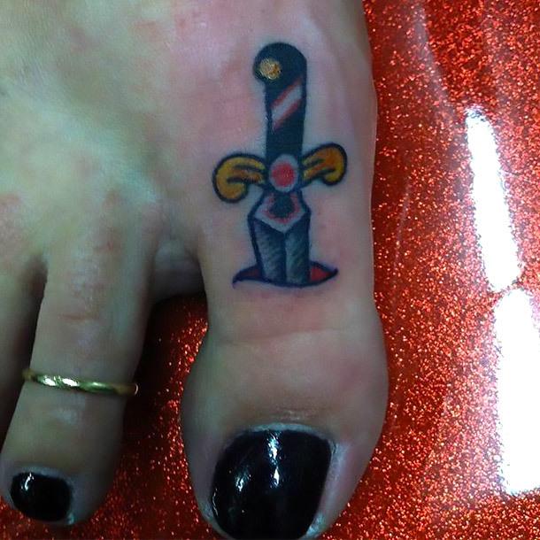 Dagger In Toe Tattoo Idea