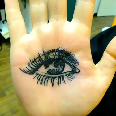 Girl Eye Tattoo on Palm Tattoo