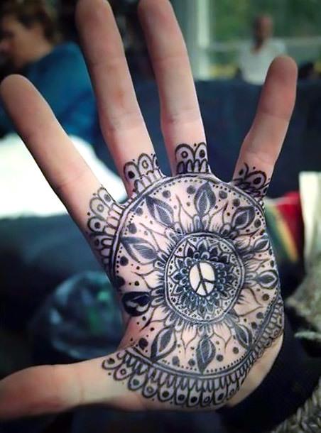 Peace Symbol on Palm Tattoo Idea
