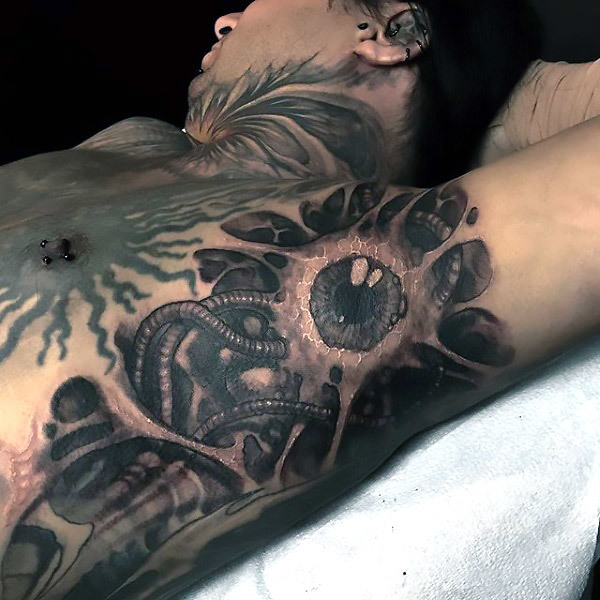 Scary Biomechanical Eye Tattoo on Armpit Tattoo Idea