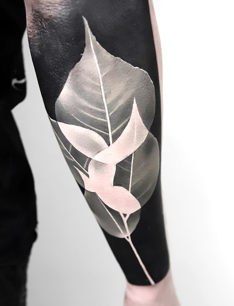 White Ink Leaves Tattoo Idea