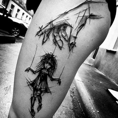 Sketch Style Puppet Tattoo
