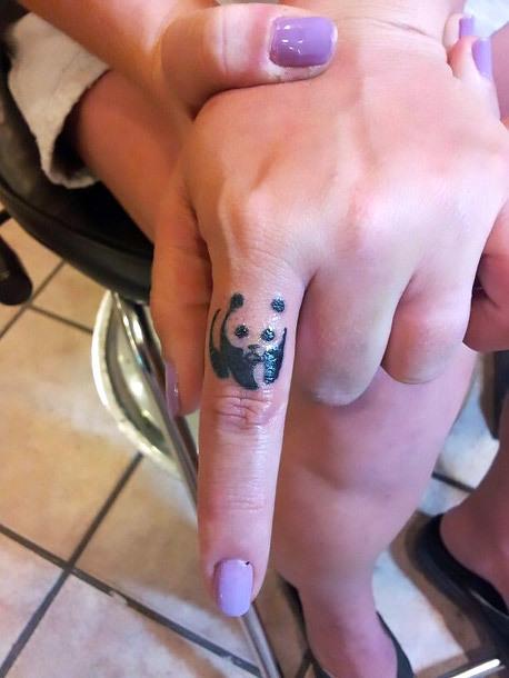 Tiny Panda Bear on Finger Tattoo Idea