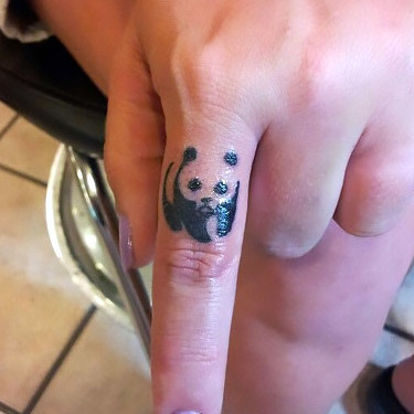 Tiny Panda Bear on Finger Tattoo