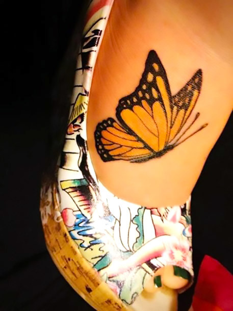 Yellow Butterfly on Foot Tattoo Idea