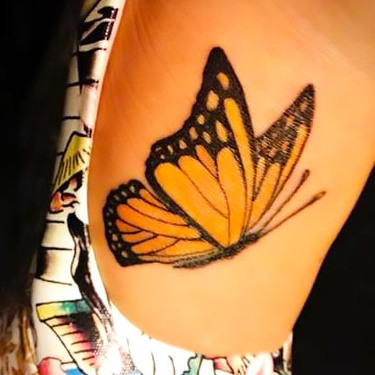 Yellow Butterfly on Foot Tattoo