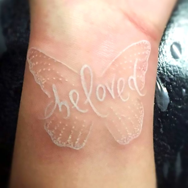 White Butterfly on Wrist Be Loved Tattoo Idea