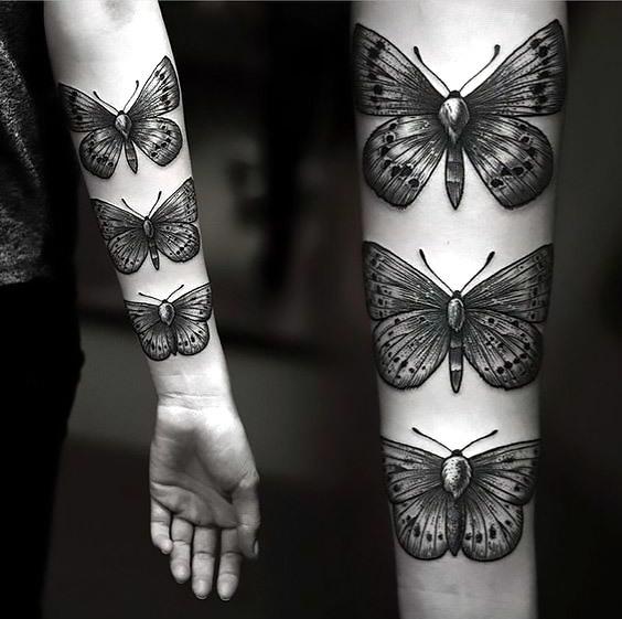 Cool Moths on Arm Tattoo Idea