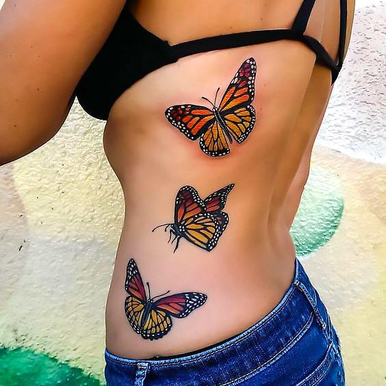 Monarch Butterflies on Side Tattoo Idea