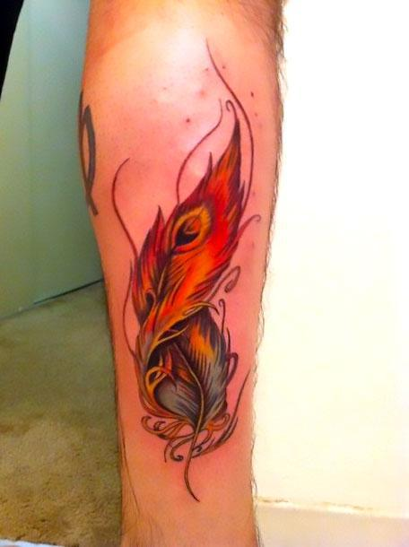 Beautiful Red Feather Tattoo Idea