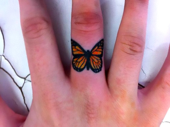 Monarch Butterfly on Finger Tattoo Idea