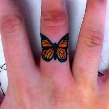 Monarch Butterfly on Finger Tattoo