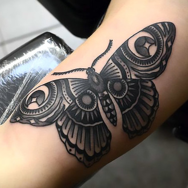 Black Butterfly on Arm Tattoo