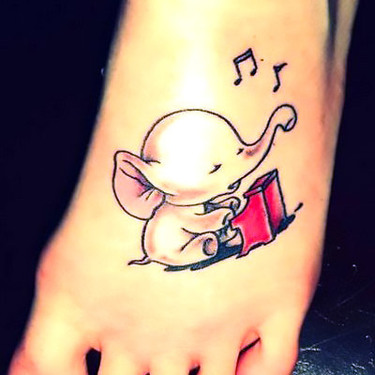Cute Elephant Playing Piano on Foot Tattoo