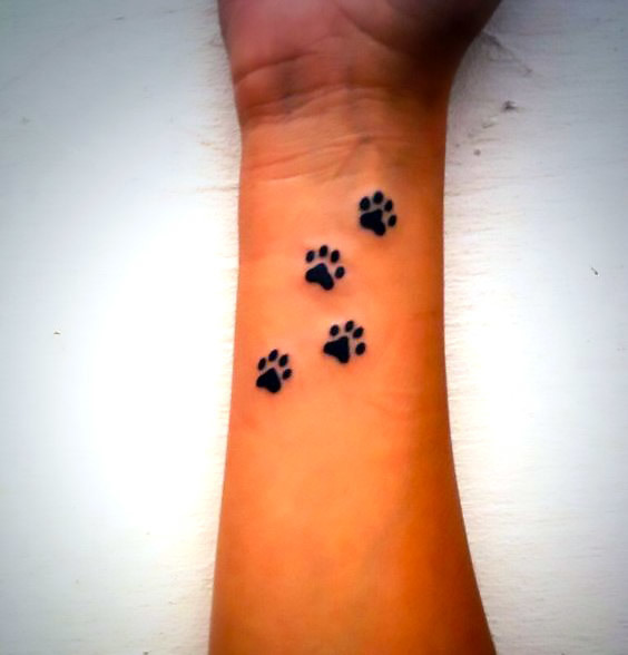 Dog Paw Prints Tattoo Idea
