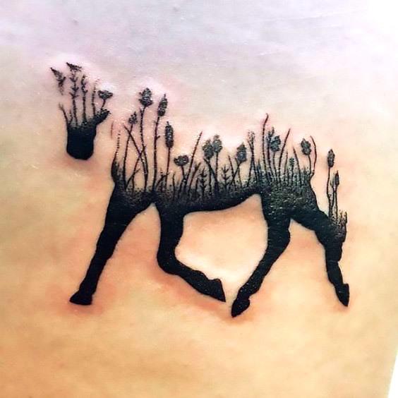 Horse Silhouette Flowers Tattoo Idea