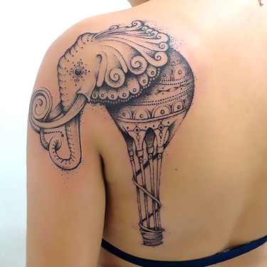 Strange Salvador Dali Elephant Tattoo