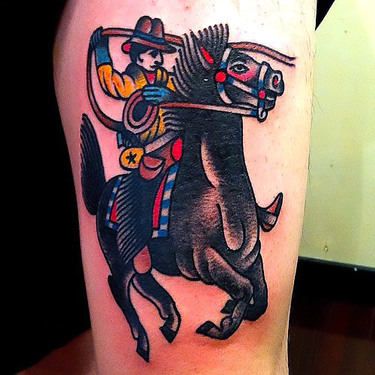 Traditional Cowboy Riding Horse Tattoo